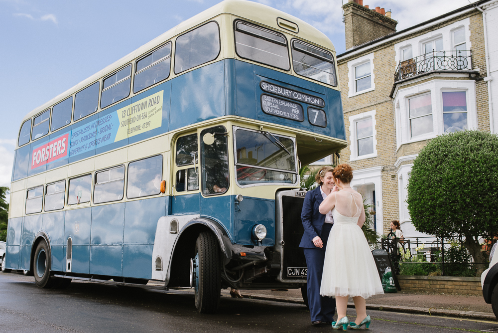 Wedding photo at Gleneagles Guesthouse couple with bus in colour
