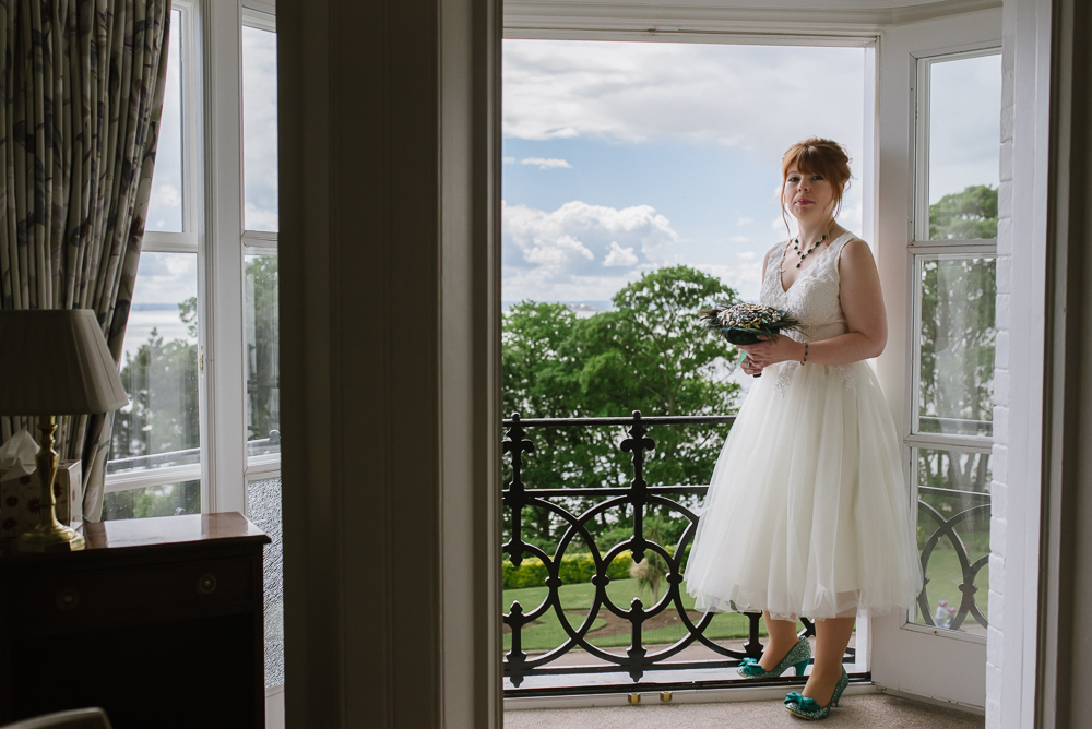 Wedding photos at Gleneagles Guesthouse bride on balcony